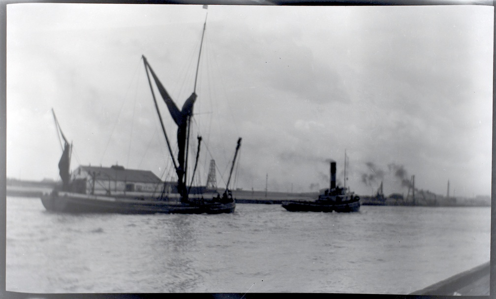 A Thames barge being towed