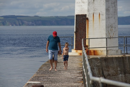 Granddad and Grandson on east harbour wall